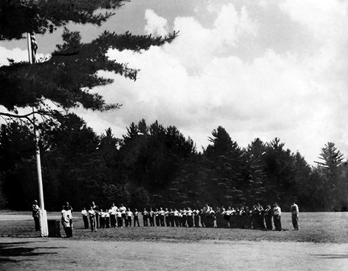 The raising of the flag at camp in the 1920s