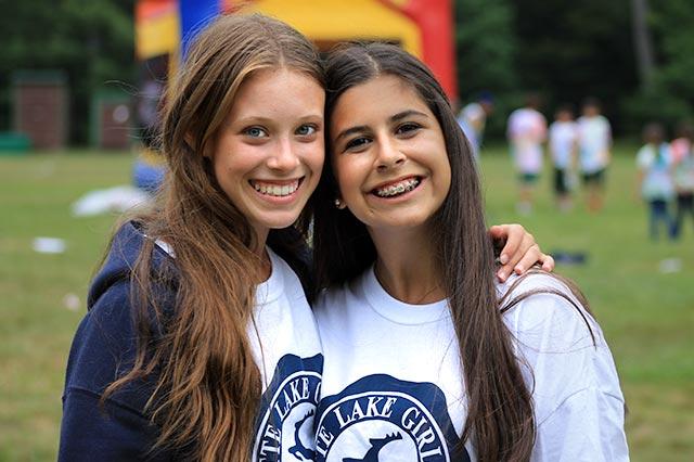 Smiling camp sisters