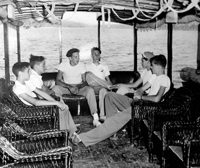 Boys relax on the water in the 1950s at Raquette Lake
