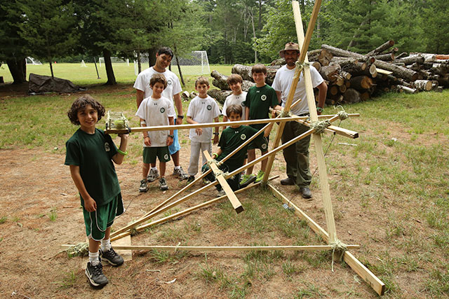 Boys at camp making a catapult
