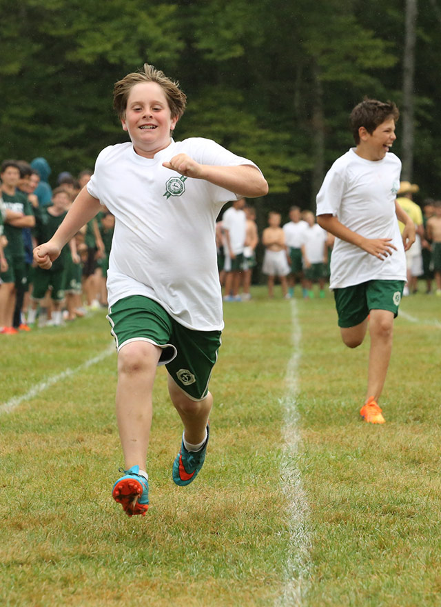 Two boys having a great time running