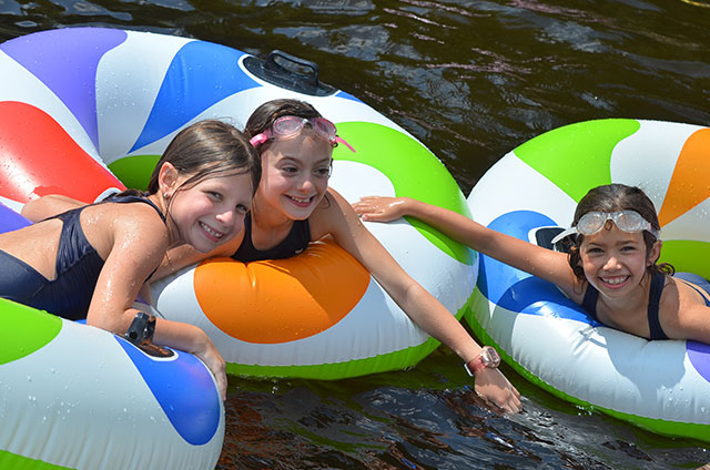 Girls in tubes in the water