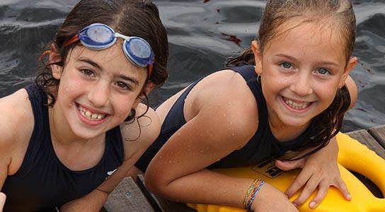 Girls swimming in the lake
