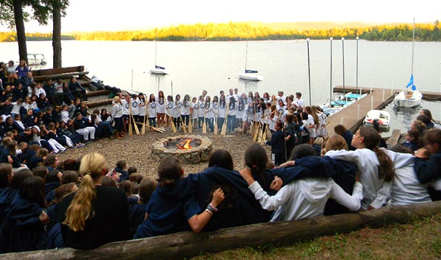 Girls around the campfire after the Saranac Trip