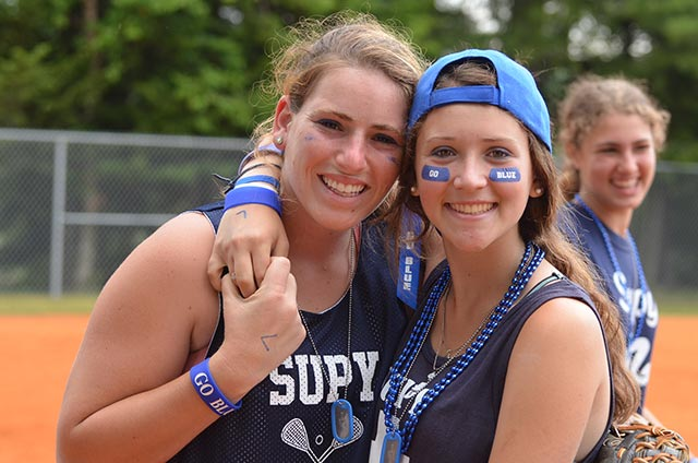 Two blue baseball players